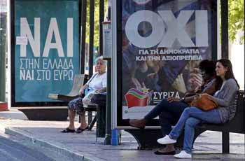 """Referendum campaign posters that reads """"No"""" and """"Yes"""" in Greek are seen on a bus stop in Athens"""