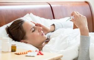La gripe en España. Mujer en la cama con gripe