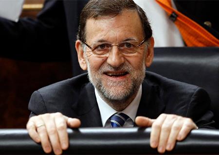 Mariano Rajoy riéndose en un pleno en el Congreso de los Diputados